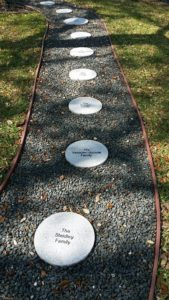 Engraved round granite paver walkway