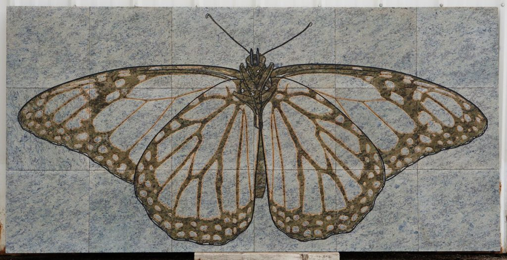 butterfly engraved on green granite