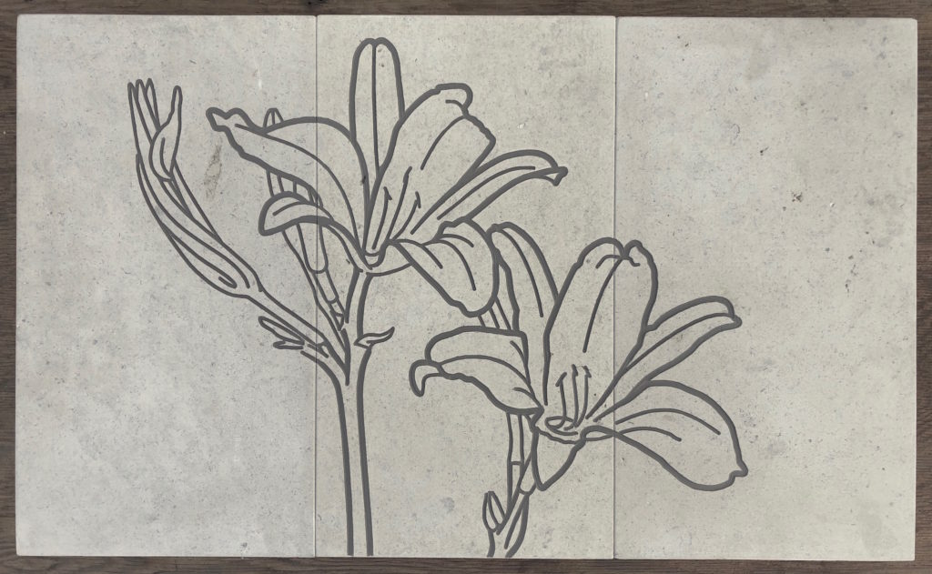 lilies engraved on limestone